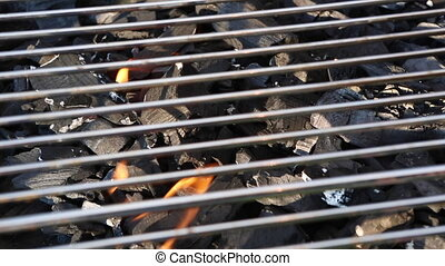 Closeup of a charcoal grill - Closeup of the fire in a...