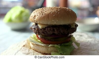 Closeup of a cheeseburger.