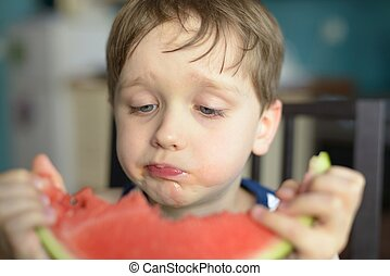 closeup of a child eating watermelon