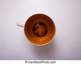 Closeup of a cup with some tea left in it - A closeup of a...