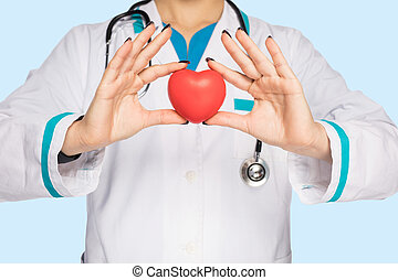 Doctor woman holding a heart in her hand