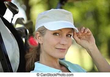 Closeup of a female golfer