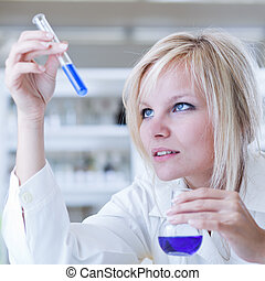 Closeup of a female researcher carrying out experiments in a...