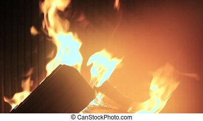 Closeup of a fire in a fireplace.