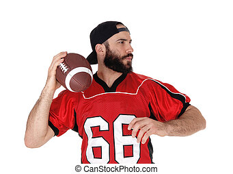 Closeup of a football player with his football in his hand