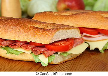 Closeup of a fresh sandwich with salami, swiss cheese and tomatoes