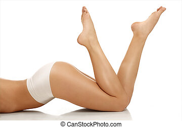 Closeup of a girl lying on the floor showing beautiful legs ...