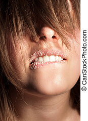 Closeup of a girl with sugar on her lips