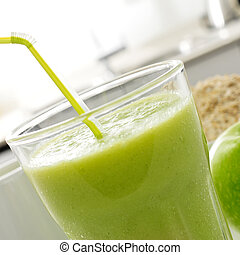 fresh green smoothie - closeup of a glass with a fresh green...