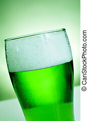 glass with dyed green beer