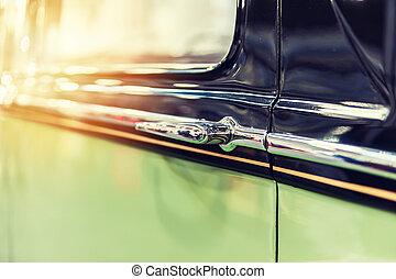 Closeup of a green vintage car