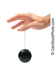 closeup of a hand playing yo-yo over white