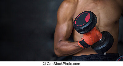 Closeup of a handsome power athletic sport man with dumbbell