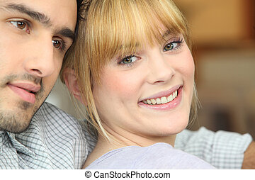 Closeup of a happy young couple at home