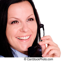 Closeup of a happy young woman using headphone
