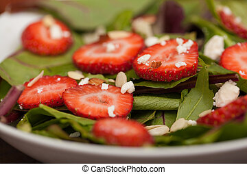Closeup of a healthy salad with strawberries
