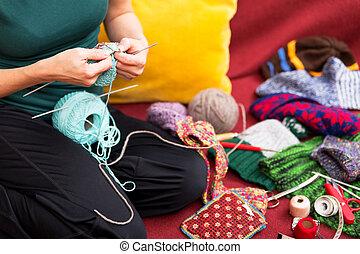 closeup of a knitting woman