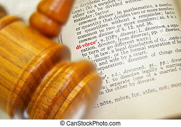 closeup of a legal gavel and divorce in dictionary