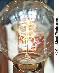 Closeup of a lit light bulb, isolated