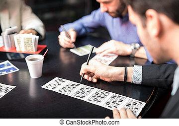 Closeup of a man playing lottery