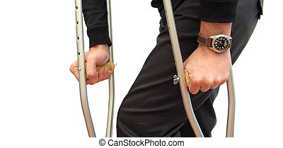 walking with crutches - closeup of a man walking with ...