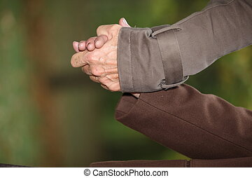 Closeup of a mature couple holding hands