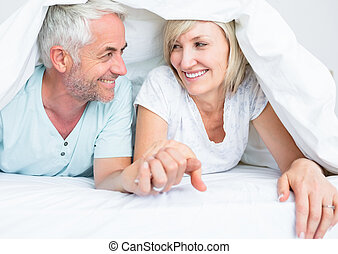 Closeup of a mature couple lying in bed - Closeup portrait...
