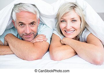 Closeup of a mature couple lying in