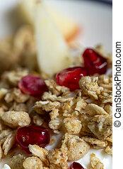 closeup of a muesli on yoghurt with pomegranate