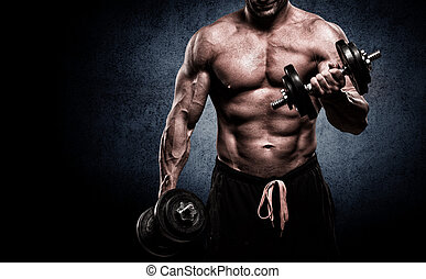Closeup of a muscular young man lifting weights on dark ...
