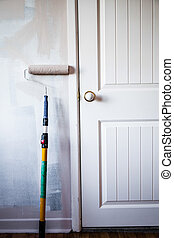 Paint Roller on the Wall - Closeup of a Paint Roller on the...
