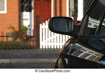 closeup of a parked vehicle outside a home