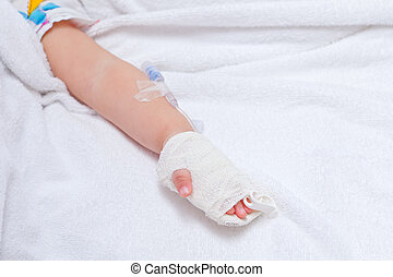 closeup of a patient hand with disposable infusion