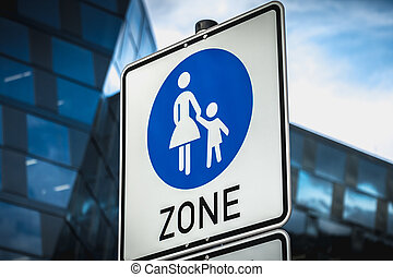 closeup of a pedestrian zone sign in the street of a modern district