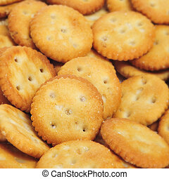 closeup of a pile of appetizing salty round crackers