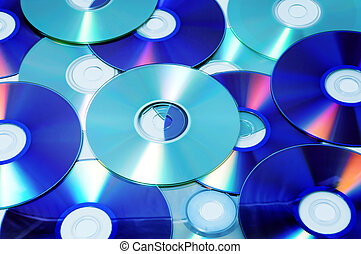 CD, CD-ROM and DVD - closeup of a pile of CD, CD-ROM and DVD