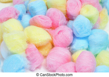 closeup of a pile of cotton balls of different colors