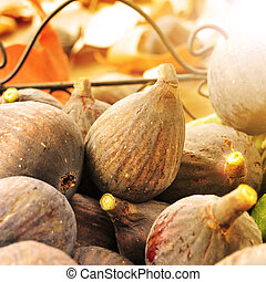 figs in a basket lit by the noon light - closeup of a pile ...