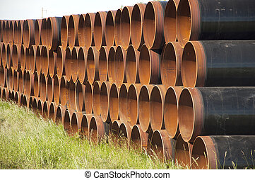 closeup of a pile of large and rusting steel pipes