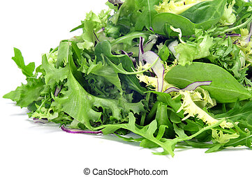closeup of a pile of lettuce mix on a white background