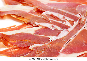 serrano ham - closeup of a pile of spanish serrano ham...
