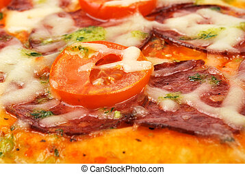 Closeup of a pizza with tomato