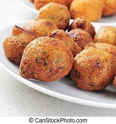 bunuelos de bacalao, spanish cod fritters - closeup of a ...