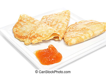 closeup of a plate with crepes and jam