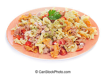 closeup of a plate with refreshing pasta salad on a white background