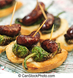 spanish pinchos - closeup of a plate with spanish pinchos...
