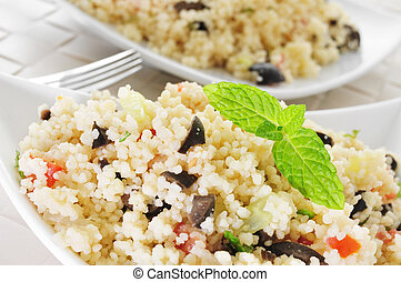 tabbouleh - closeup of a plate with tabbouleh, a typical ...