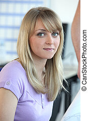 Closeup of a pretty woman in an office environment