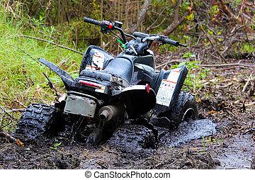 Closeup of a quad stuck in mud