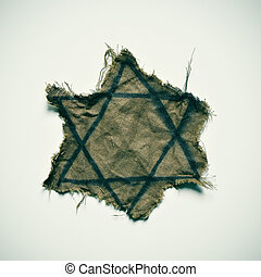 ragged Jewish badge - closeup of a ragged Jewish badge on an...
